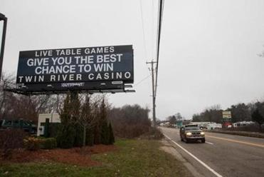 A billboard advertised for the Twin River Casino a half mile from the Plainridge Casino in Plainville, Mass.